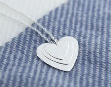 Handmade sterling silver pendant, 3 hearts layered on top of each other, on a silver rope chain