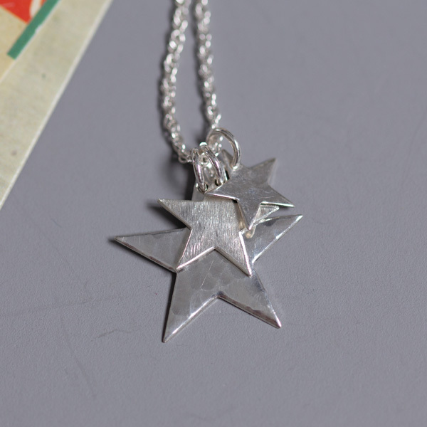 A small, medium and large star, textured one side and hammered the other side