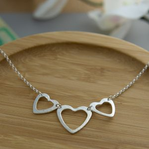 2 smaller and one large open heart, handmade sterling silver