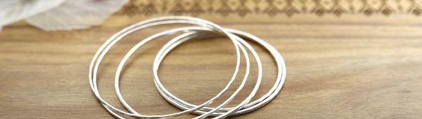 A stack of 2mm sterling silver bangles.
