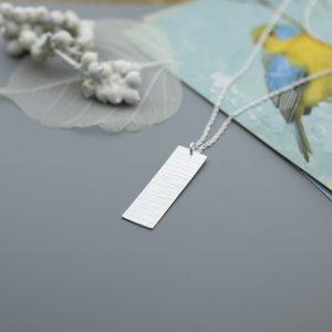 Rectangular sterling silver pendat with cross pein pendant