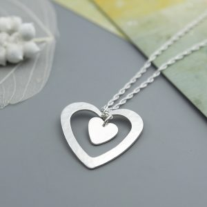 Handmade Sterling silver heart within a heart pendant on a rope chain