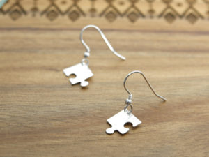 A pair of handmade sterling silver jigsaw corner earrings
