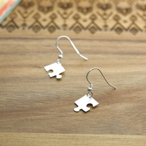 A pair of handmade sterling silver jigsaw corner earrings