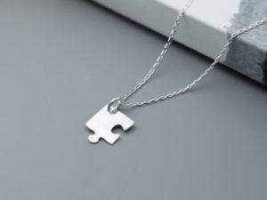 Handmade Sterling silver jigsaw on silver chain