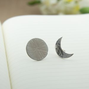 Pair of sterling silver sun and moon studs