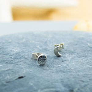 Tiny pair of sterling silver sun and moon stud earrings