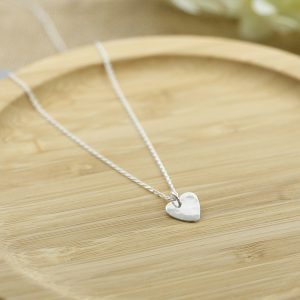 Handmade sterling silver heart pendant on a chain