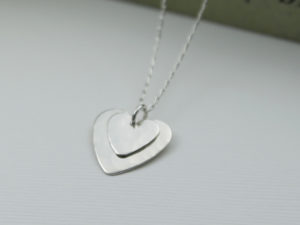 Handamde sterling silver pendant, 2 different size hearts layered on top of each other