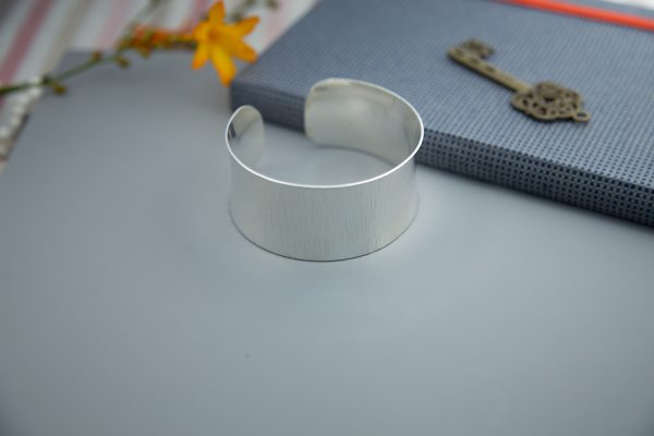 large Sterling silver cuff with cross pein hammer marks