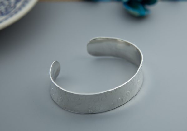 Sterling silver medium sized cuff with small discs hammered effect