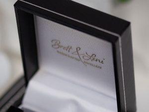 Black gift box showing Logo