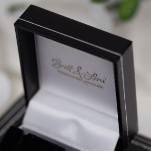 Black gift box showing Logo