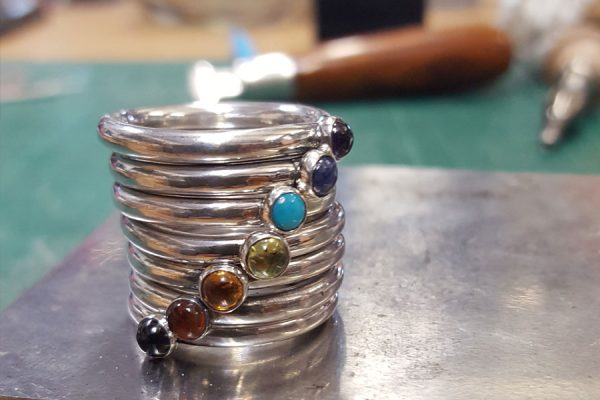 7 rings with gemstones representing the 7 chakras