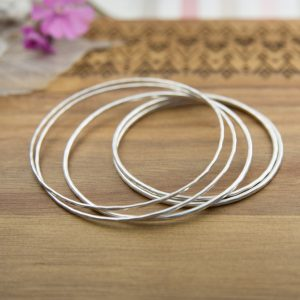 Various sizes of sterling silver stacking bangles