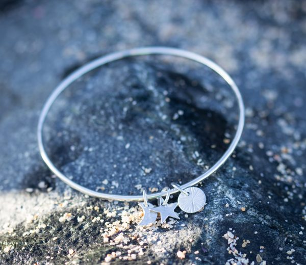 2mm sterling silver bangle with Sun, moon and star charms