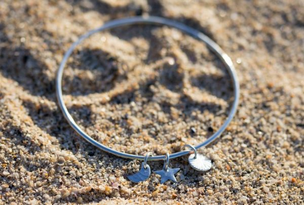 2mm silver bangle with 3 charms, a sun, moon and a star