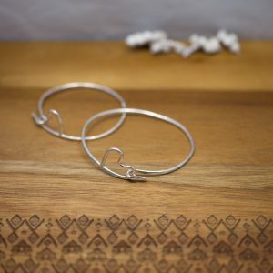 Bangle smade from a single peice of wire with hearts as clasps