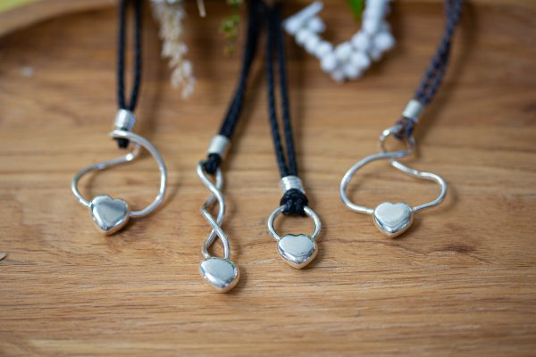 4 solid heart pendants on leather cord