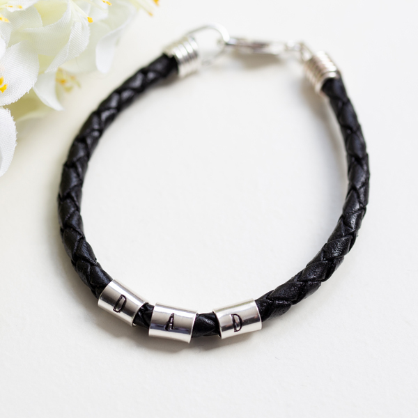 Black leather bracelet with sterling silver 'Dad' stamped on 3 rings