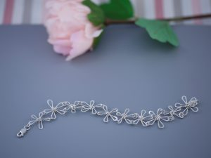 Sterling silver bracelet made up of handmade wire daisies