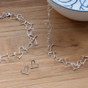 Sterling silver necklace of tiny hearts made of wire.