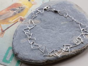 Sterling silver bracelet made tiny wire hearts