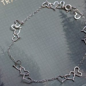 tiny wire hearts with chain making up a lovely anklet